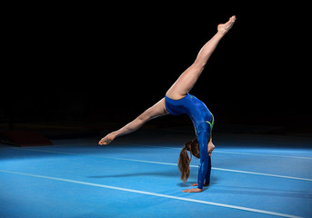 Autocollant pour porte Gymnastique portrait of young gymnasts competing in the stadium