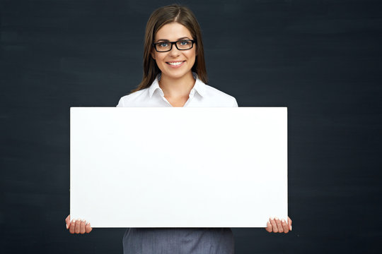 smiling business woman holding advertising board.