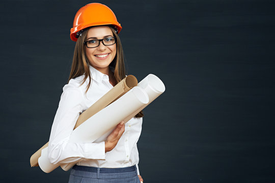 Young woman architect holding blueprint.