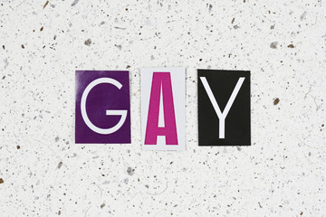 gay word on handmade paper texture
