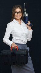 Smiling business woman holding box tools.