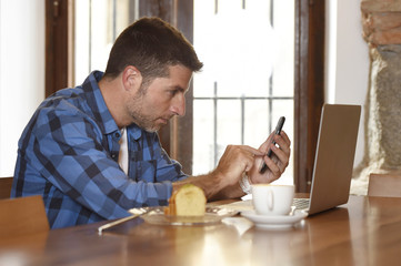 businessman or student working with laptop computer at coffee shop having breakfast