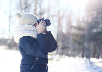 Child little boy photographer takes picture on the digital camer