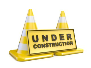 Yellow UNDER CONSTRUCTION sign and two road cones