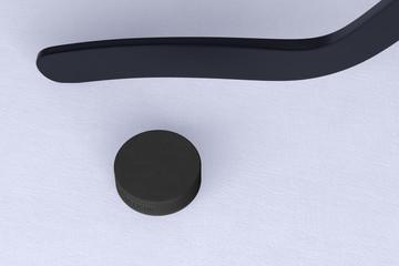 Hockey puck and hockey stick on ice