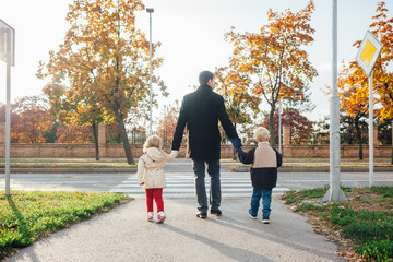 Father with children walking