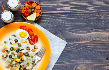 Vegetarian fresh salad with white rice  on wooden background