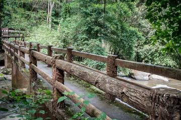 Concrete footbridge over the stream