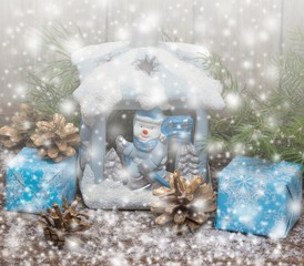 Winter. Christmas Gifts . Wooden Background with Drawn Snowfall. Toned.