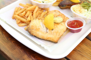 fried fish with lemon on top