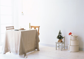 interior of small white room with table and fir
