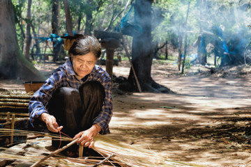 Older women in Asia are using mortars in traditional Asian cooki