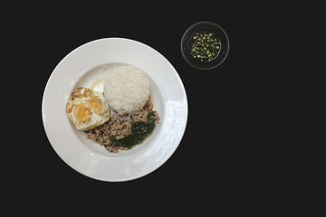 Rice topped with Fried Stir Basil , Minced pork and egg isolated