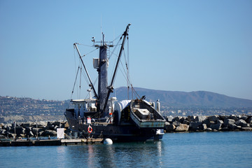 old vintage fishing boat docked near jetty
