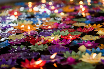 Floating flower candles in water  for make merit in the Buddhist