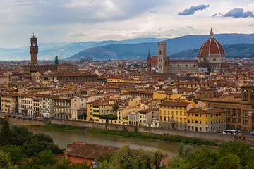 Cityscape View of Arno river, tower of Palazzo Vecchi, Florence Duomo, Saint Mary of the Flower, Cathedral Santa Maria del Fiore in evening in Florence, Italy