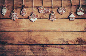 christmas decoration hanging on wooden background with space
