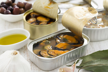 seafood in iron box on wooden background