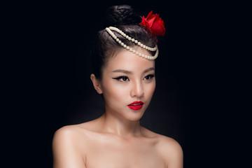 Fashion studio shot of beautiful young asian woman with retro ha