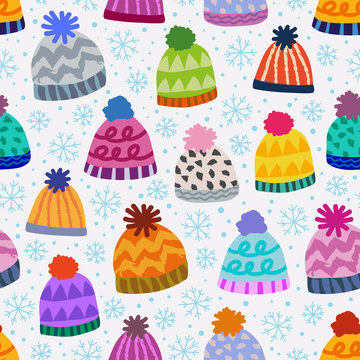 seamless winter pattern with caps and snowflakes