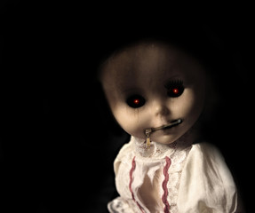 Vintage evil spooky doll with zipped mouth