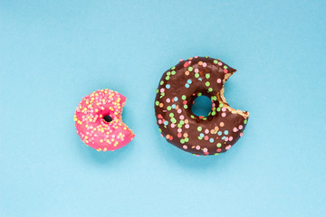 Sweet donuts on the blue background.