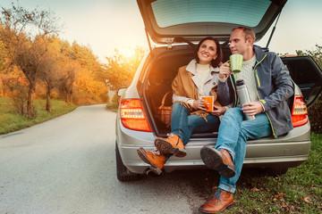 Couple have a tea break on their auto travel