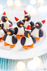 olive penguins snack with santa hat