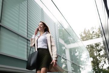 Beautiful businesswoman walking outdoors