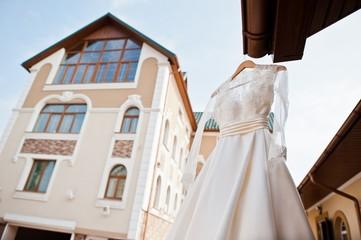 Elegant wedding dress of bride outdoor