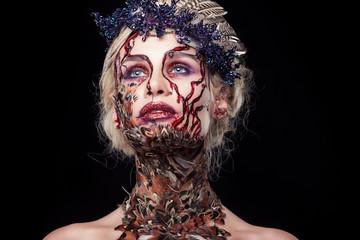 Close portrait of a girl for Halloween. Blond beauty portrait. T