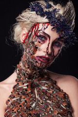 Close portrait of beauty. Halloween. The girl blonde on a black