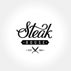 Steak lettering logo gray