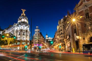 Keuken foto achterwand Madrid Rays of traffic lights on Gran via street, main shopping street in Madrid at night. Spain, Europe.