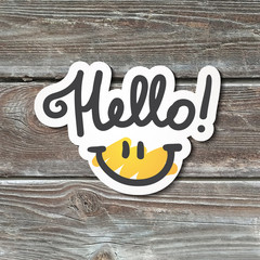 hello lettering with smile, handwritten text, paper sticker on realistic wood texture