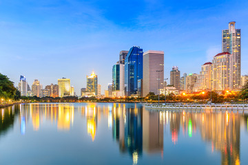 Modern Office Buildings in Bangkok, Thailand, at Twilight with Blue Sky