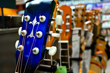 Guitars hanging on wall of music studio