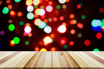 Christmas bokeh background with empty wooden table. Perfect for product display montage