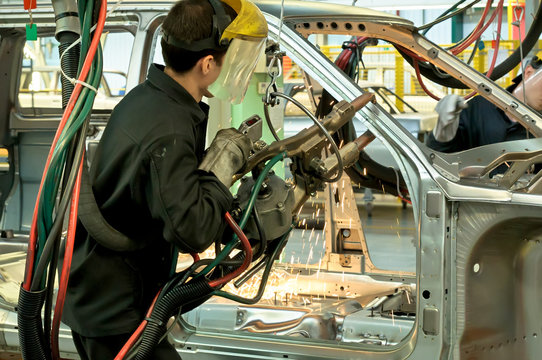 Cherkasy, Ukraine - May 29, 2012:Working welder at the plant for the production of cars.