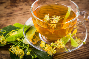 Green herbal tea with linden flowers, closeup