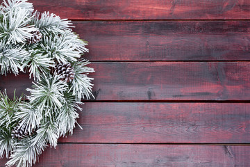 Traditional pine Christmas wreath frosted in snow