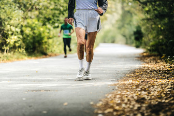 old man running in autumn Park. physical activity and a healthy lifestyle Wall mural