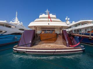 Rear of a large mega yacht at dock