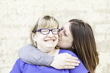 Women friends kiss
