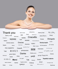 Beautiful girl with a billboard of  languages