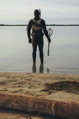 Male diver in water for spear fishing