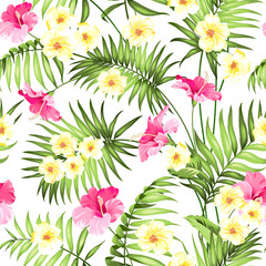 Seamless tropical flower. Tropical flowers and jungle palms. Beautiful fabric pattern with a tropical flowers isolated over white background. Blossom plumeria for seamless pattern background.