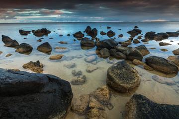 Idyllic scene of rocks on the shoreline