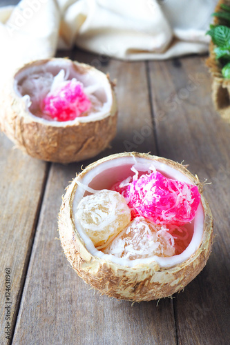 ... asian steamed cassava cake with shredded coconut in a coconut shell