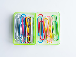 colorful paper clips with green box